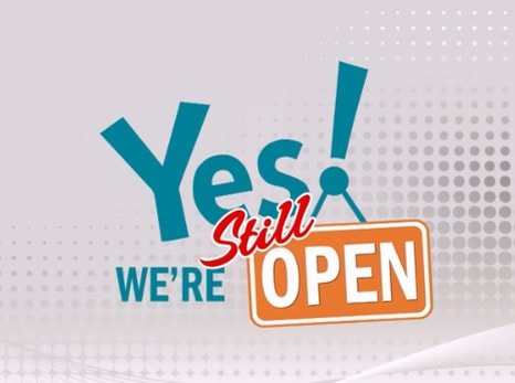 Yes, We're Still Open Sign